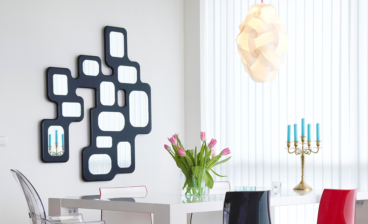 Lucio Wall Lamp is an evenly backlit frame of 12 mirrors creating a silhouette of a modern organic shape when it's dark